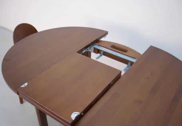 стол для кухни поворотными центральными вставками.